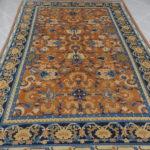 tappeto cinese da sala color salmone e blu