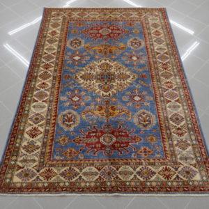 tappeto kazak fondo celeste da sala